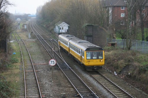 then returns on the 'down' line, passing the remains of Cock Robin footbridge which linked Tan Pit Lane with Devonshire Road until the extension of the M602 in the early 1980s