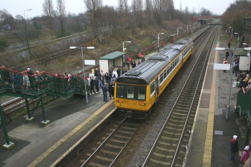 142055 brings another full load of Manchester-bound passengers at 1339